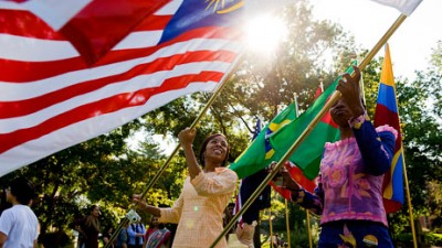 A Mizzou student carries a Malaysian flag
