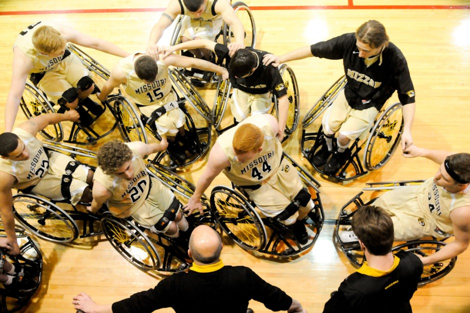 Mizzou Wheelchair Basketball Team players gather in a circle