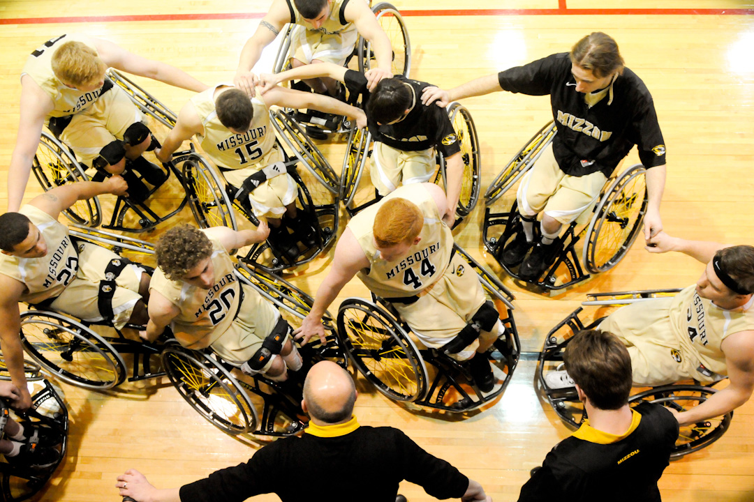 Mizzou Wheelchair Basketball Team players gather in a circle
