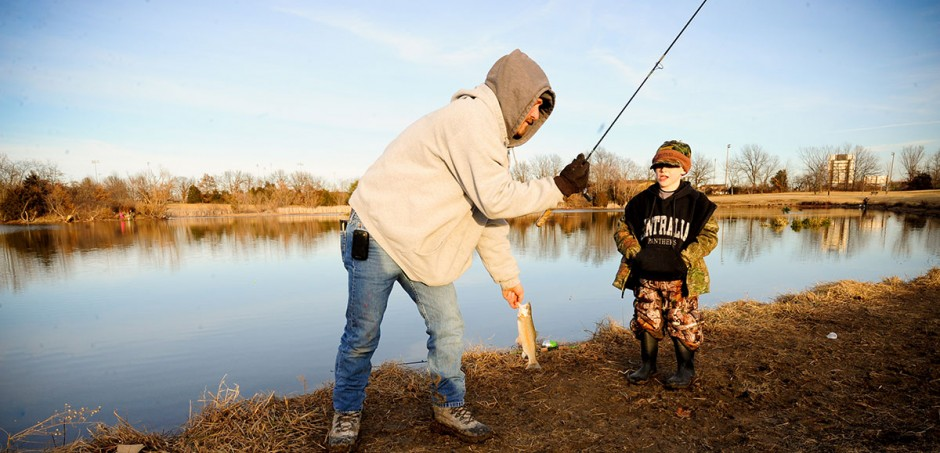 Cooper Stickney, a first-time fisherman at Bethel Lake, gets some help from his dad, Ronny