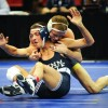 Junior Alan Waters holds Penn State's Nicholas Megaludis