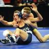 Junior Alan Waters holds Penn State's Nicholas Megaludis