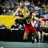 Nahshon Garrett lifts Alan Waters off the mat