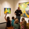 Kids sitting in museum learning about modern art