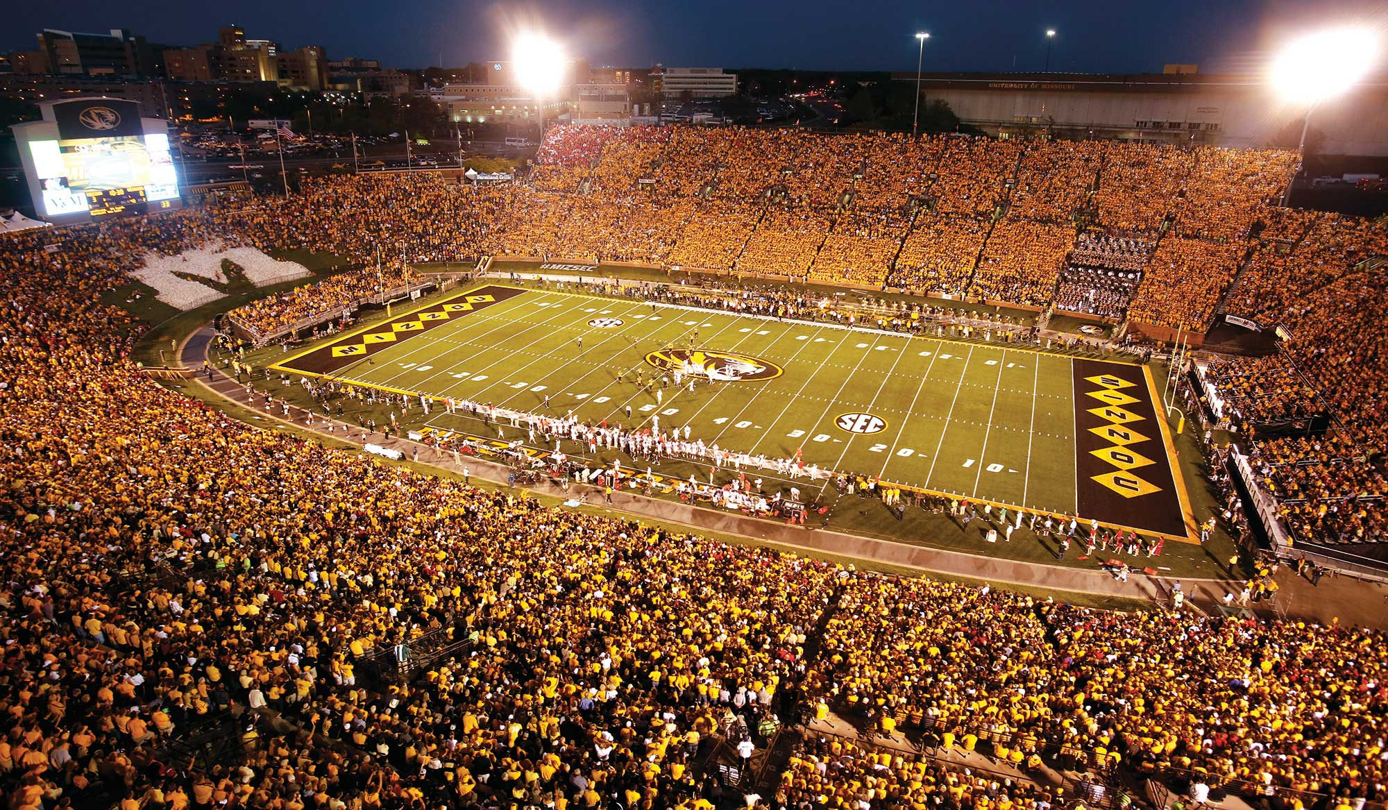 Memorial Stadium filled with black and gold fans