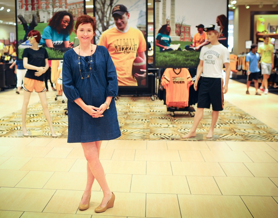 Michelle Froese stands in front of mannequins inside The Mizzou Store
