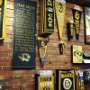 Mizzou banners an pennants hang on brick wall