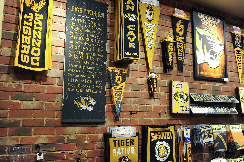 Mizzou banners an pennants hang on brick wall