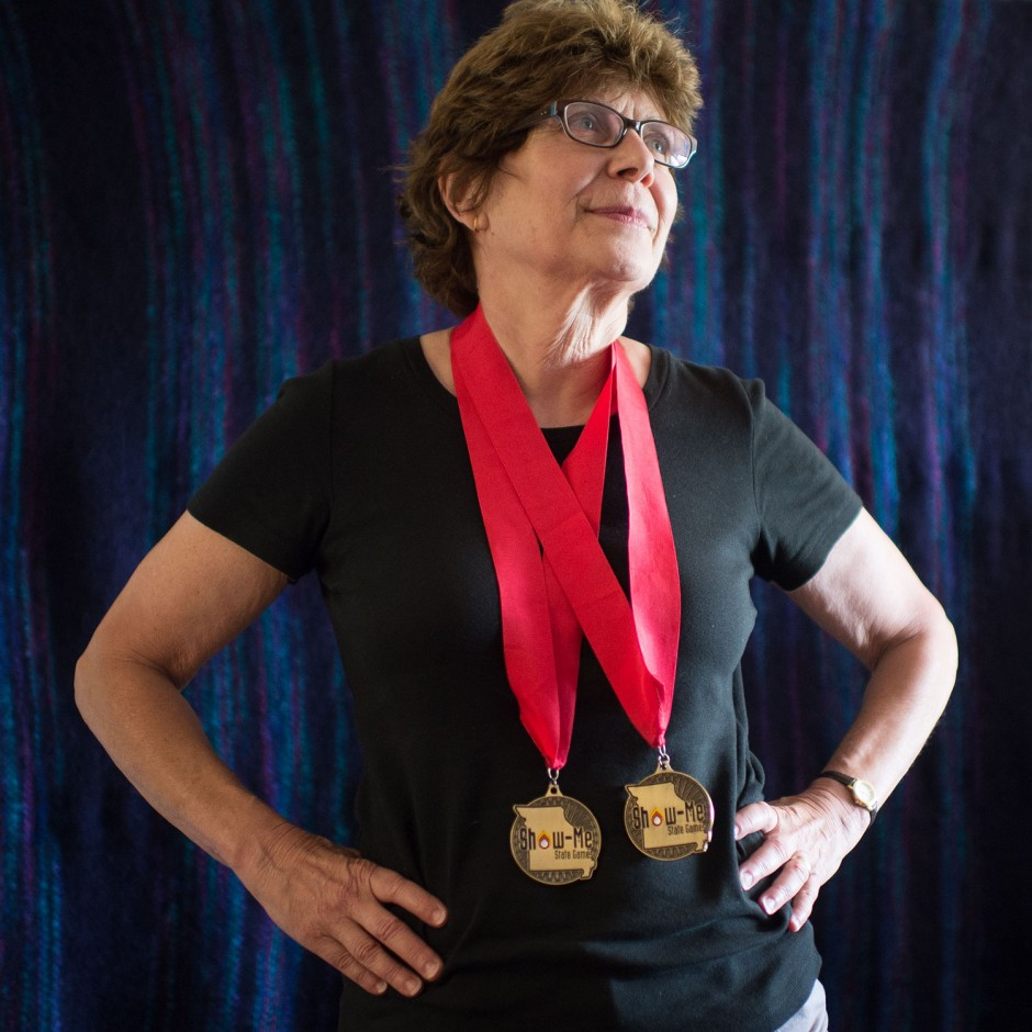 Louise Miller stands with two medals around her neck.