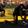 Missouri Tigers players Wide Receiver, L'Damian Washington (2), and Defensive back, E. J. Gaines