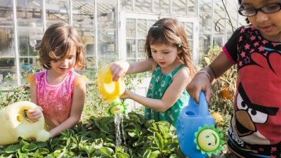 Children watering plants
