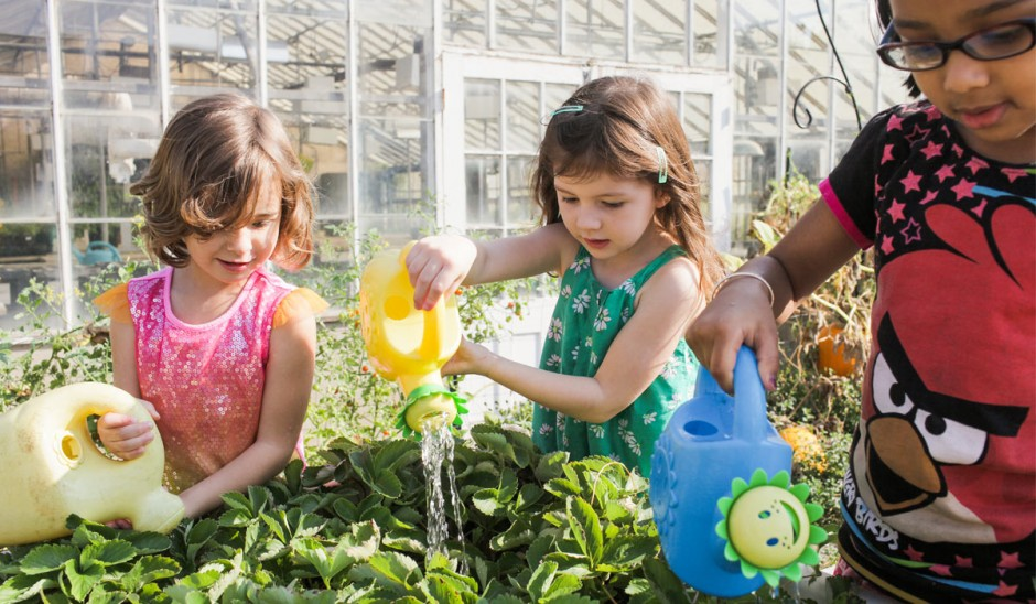 Children watering plants