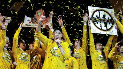 Coach Wayne Kreklow and the Mizzou volleyball team celebrate winning MU's first SEC title