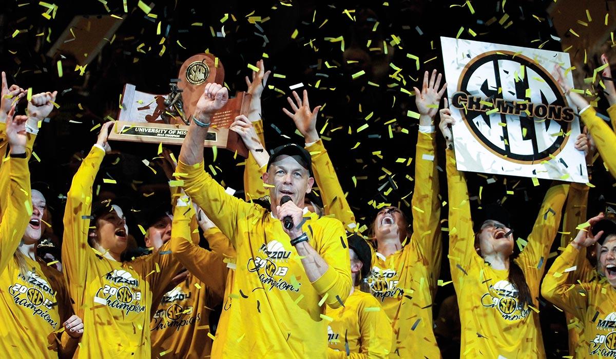 Coach Wayne Kreklow and the Mizzou volleyball team celebrate winning MU's first SEC title