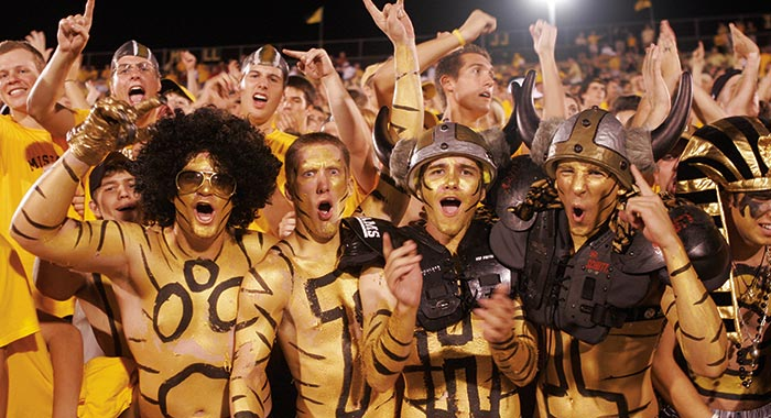 Guys in gold paint and costumes at a Mizzou football game