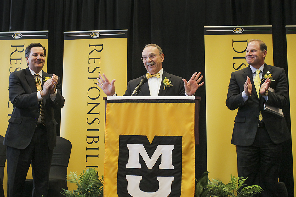 Interim Chancellor Steve Owens, left, and UM System President Tim Wolfe applaud for R. Bowen Loftin.