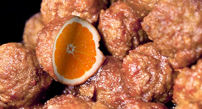 Illustration of meatballs with one cut open reveling an orange center