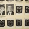 A reference chart hangs in University Archives with photos and terms of service for past presidents and chancellors.