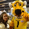 Truman and a Mizzou cheerleader pose for the camera before the game.