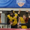 Quarterback Maty Mauk receives some support from a fan as he re-enters the field after running out of bounds.