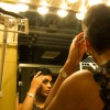 Sini Stephan, a graduate student studying journalism, gets ready in the dressing room before the start of the first round of Mizzou Idol at the Missouri Theatre. Stephan was the only graduate student to participate in the annual student talent competition.
