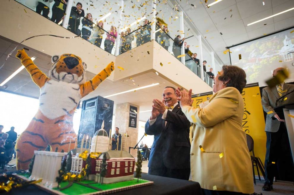 Truman, Chancellor Loftin and Cindy Mustard with cake and confetti.