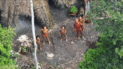 People from isolated Amazon tribe looking up.