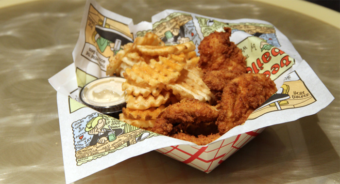 Chicken with waffle fries.