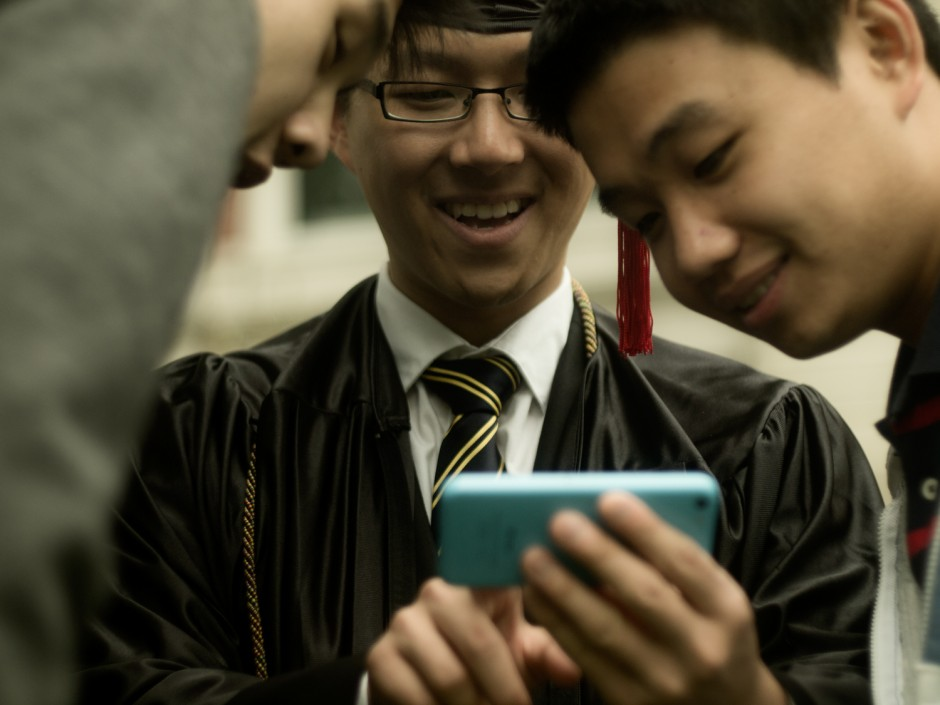 Chinese student with cell phone.