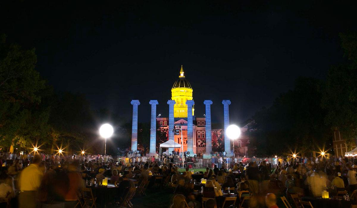 Jesse and the columns lit up at night