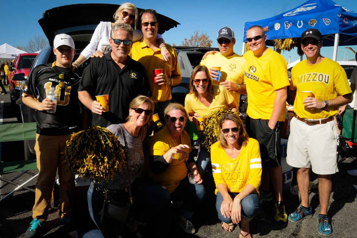 Tigers fans tailgate outside of Memorial Stadium before the game.