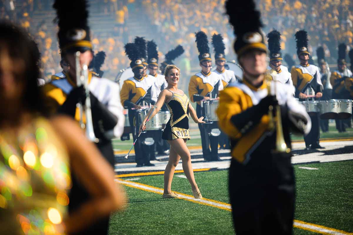 A featured twirler performs during pre-game festivities.
