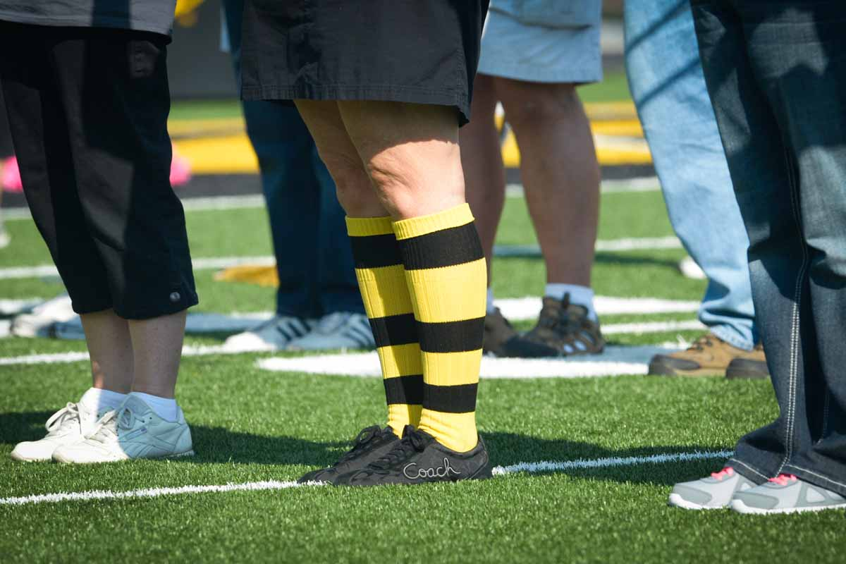 A member of the alumni band sports black and gold socks.