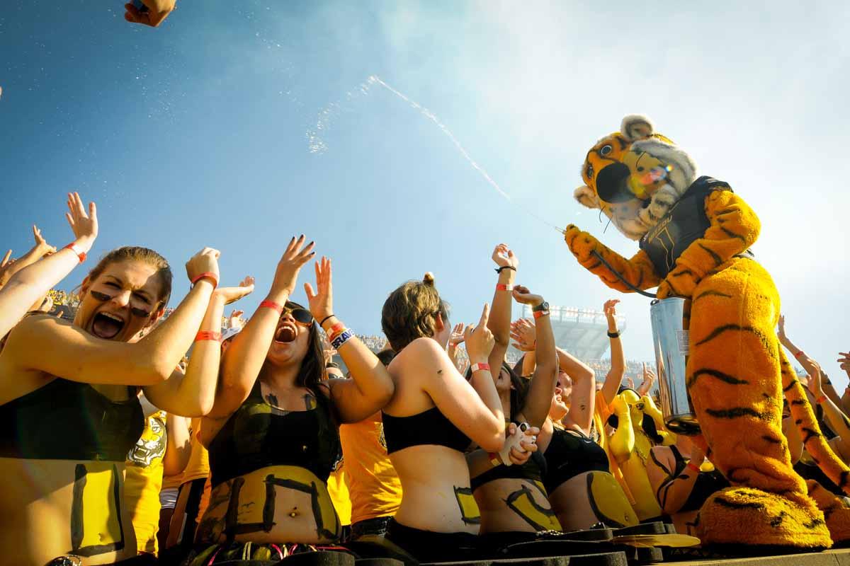 Truman sprays the Tiger Lair.