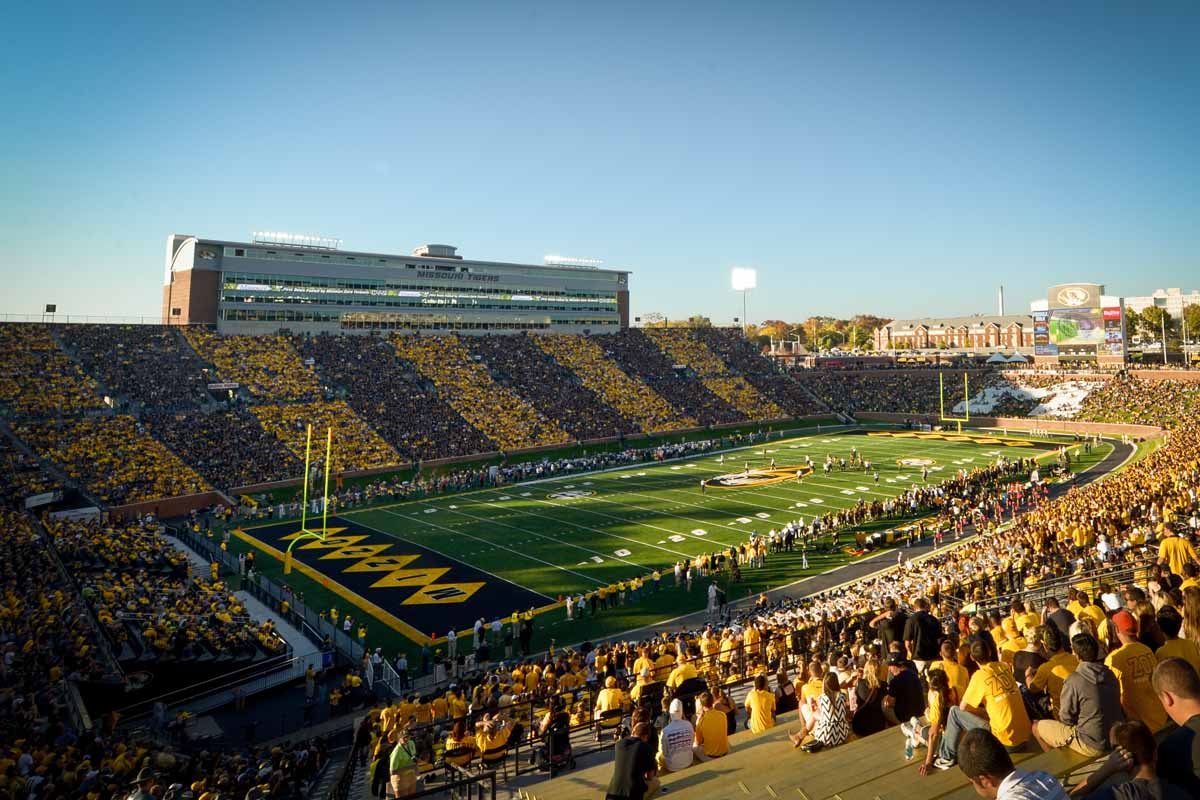 A crowd of 65,264 fans dress in black and gold to create tiger stripes in the stands.