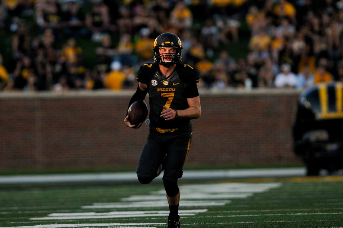 Quarterback Maty Mauk runs for a gain in the third quarter. His 36-yard rush in the third quarter to set up a touchdown was the longest run of his career.