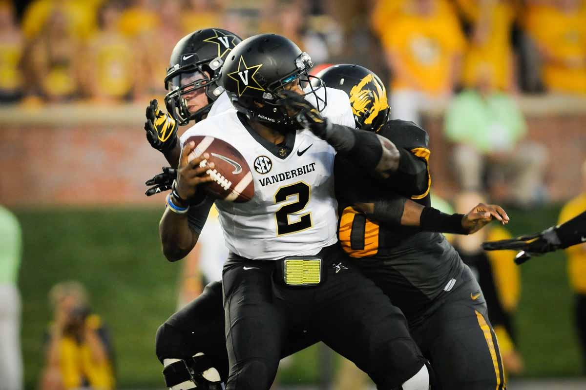 Defensive lineman Harold Brantley sacks Vanderbilt's quarterback for a loss in yards near the end of the fourth quarter.