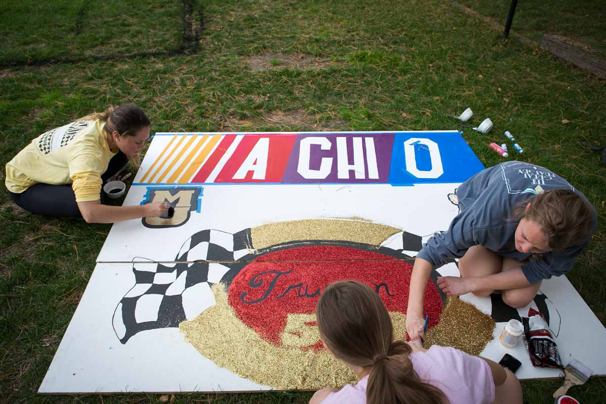 Students painting signs