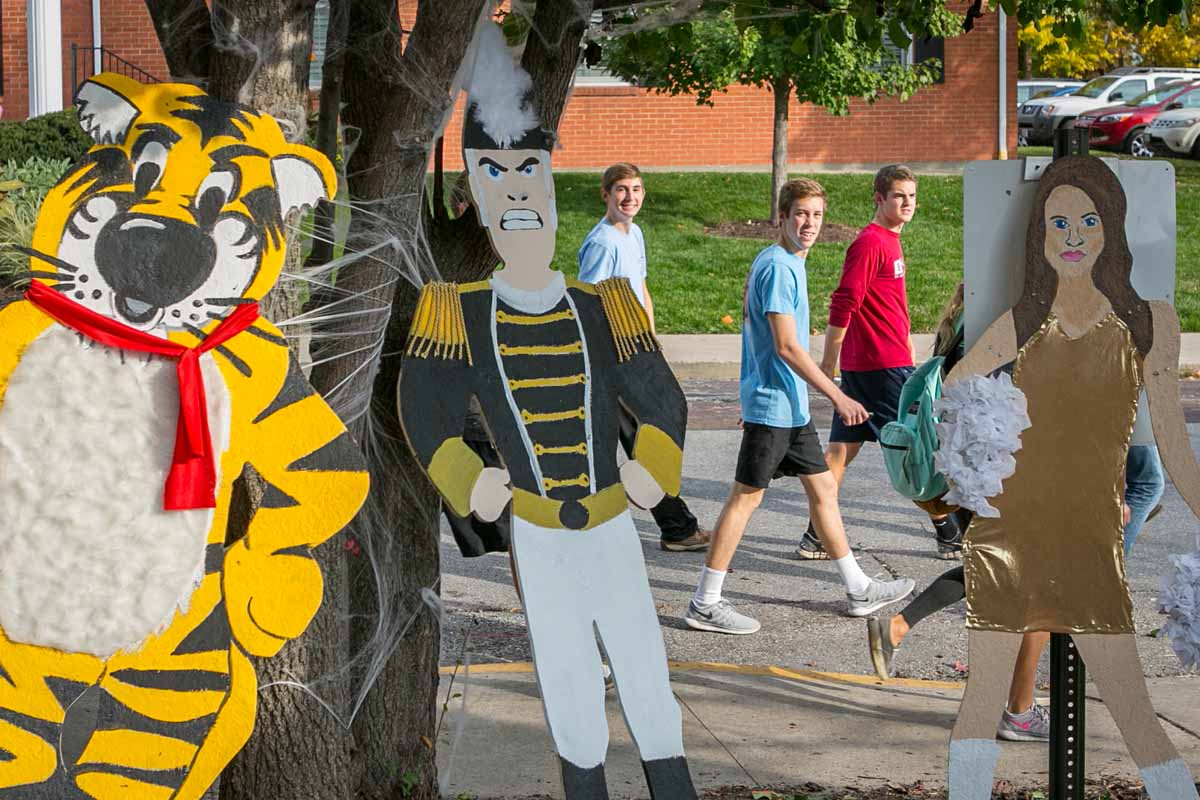 Students walk by cutouts of Truman and Golden Girls.