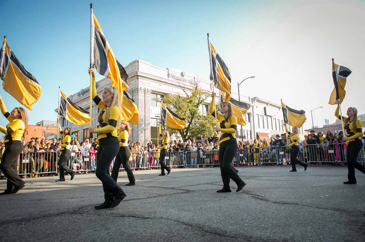 The MU color guard performs downtown at the Homecoming Parade.