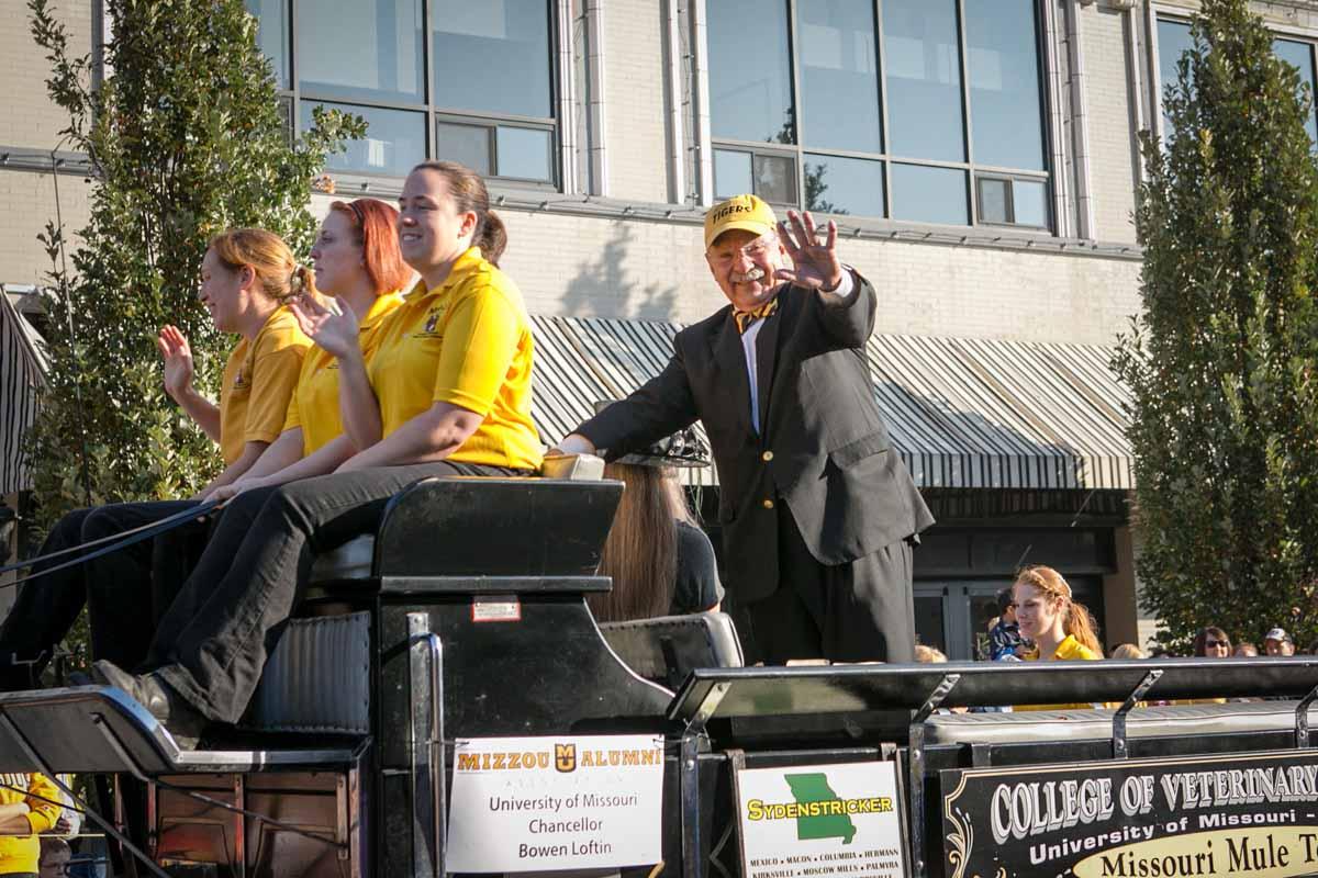 Chancellor Loftin waves to the crowd at the Homecoming Parade.