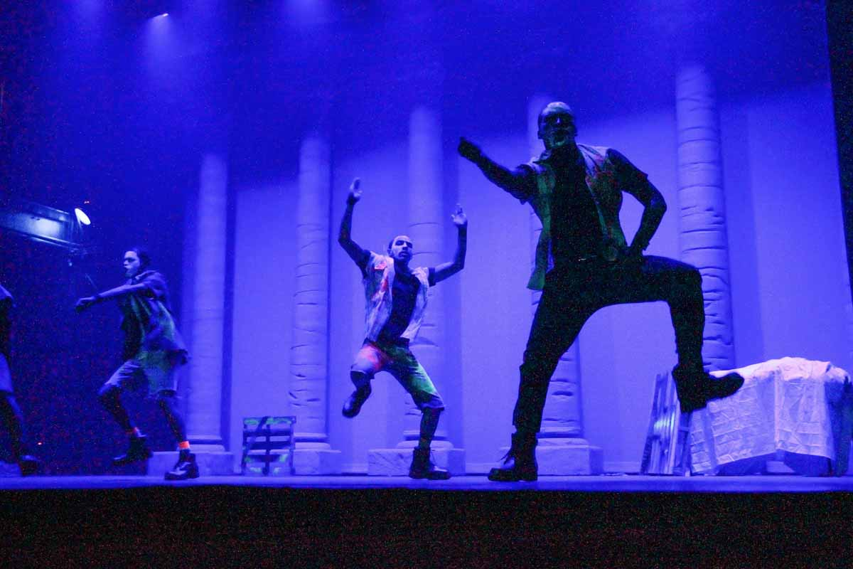 Students dancing on stage.