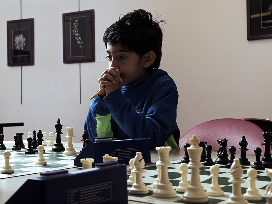 Saatvik Kannan, 8, waits for his chess opponent to make her move