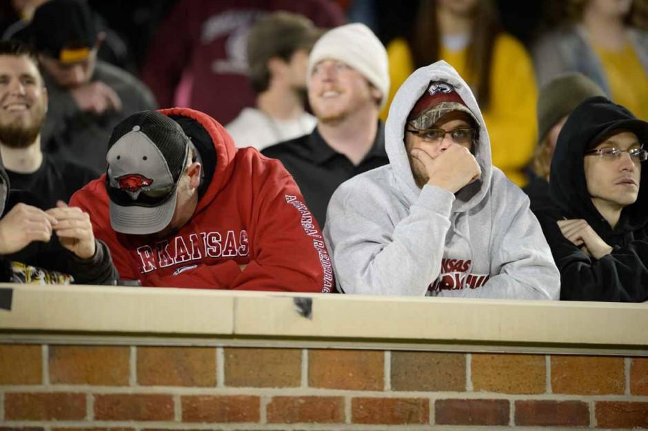 Dejected Arkansas fans