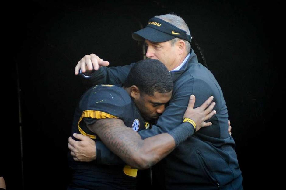 Marcus Murphy hugging Gary Pinkel