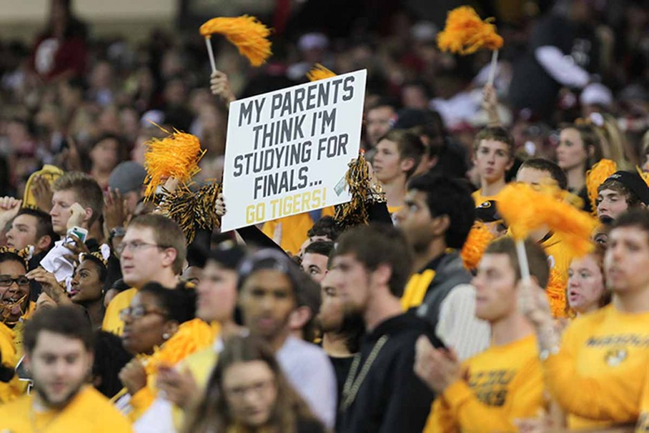 Crowd of Mizzou fans holding signs.