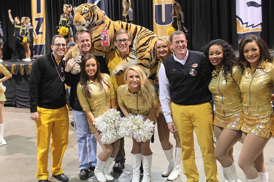 Tim May, Paul Shomper, Philip Schroeder and Ron Henry with dancers and stuffed tiger.
