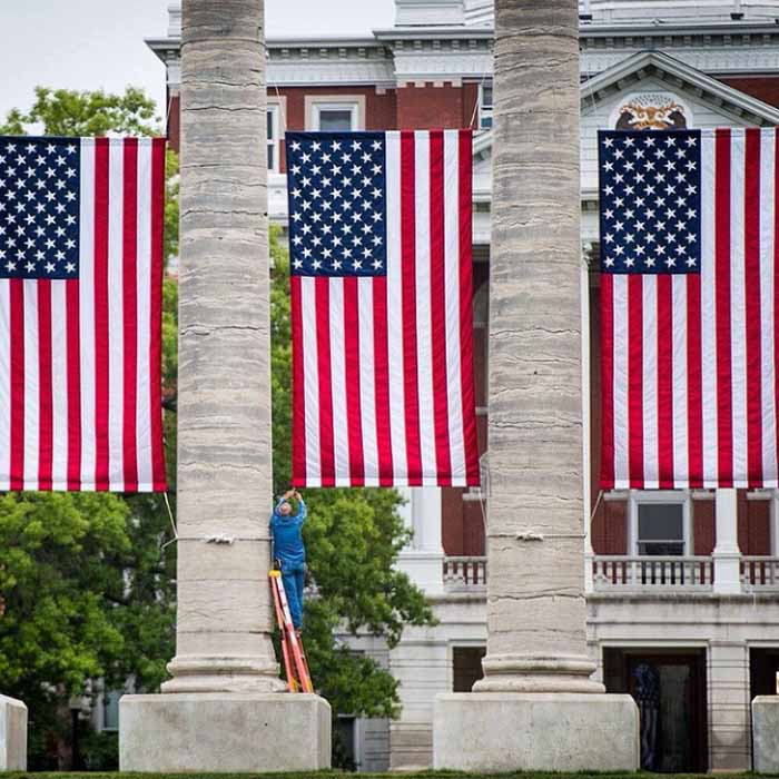 American flags between the Columns.
