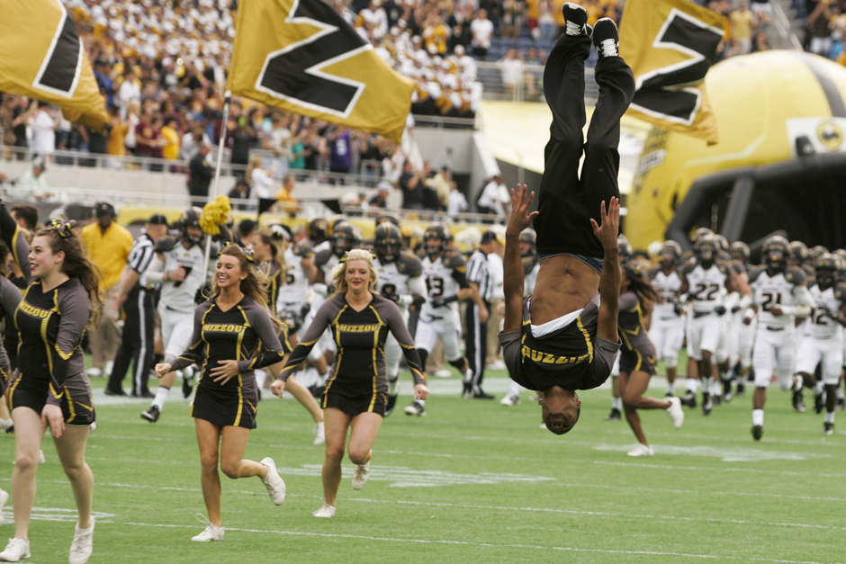 Cheerleader doing flips.