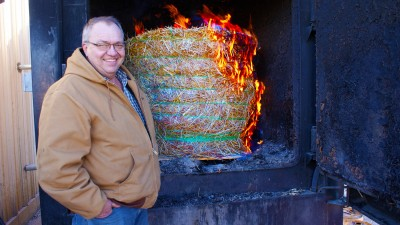 Tim Reinbott with burning switchgrass.